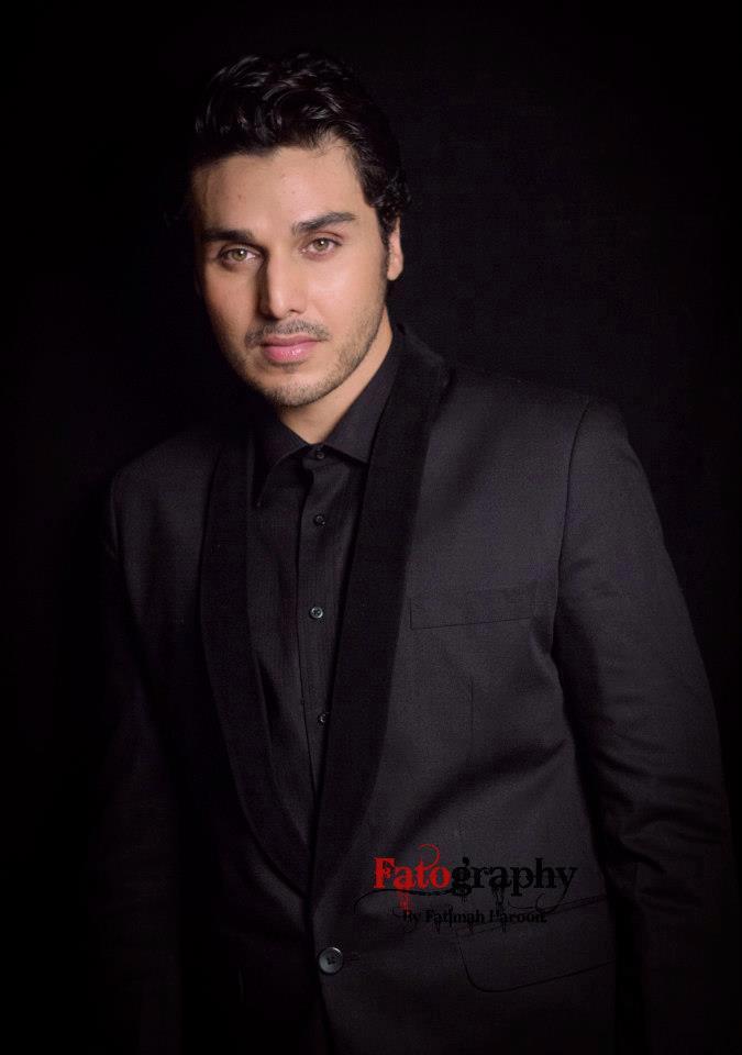 ahsan khan wearing black suit