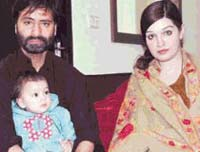 Yasin with daughter and wife Mashaal