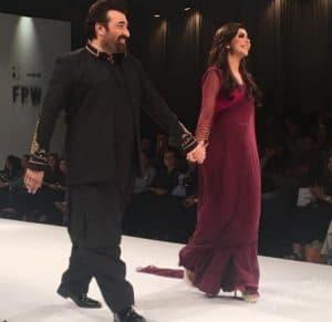 Nida and Yasir walk the ramp together