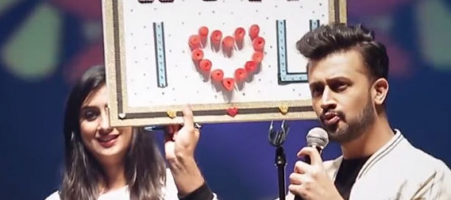 Fan girl comes up on stage and refuses to let go during Atif Aslam's concert