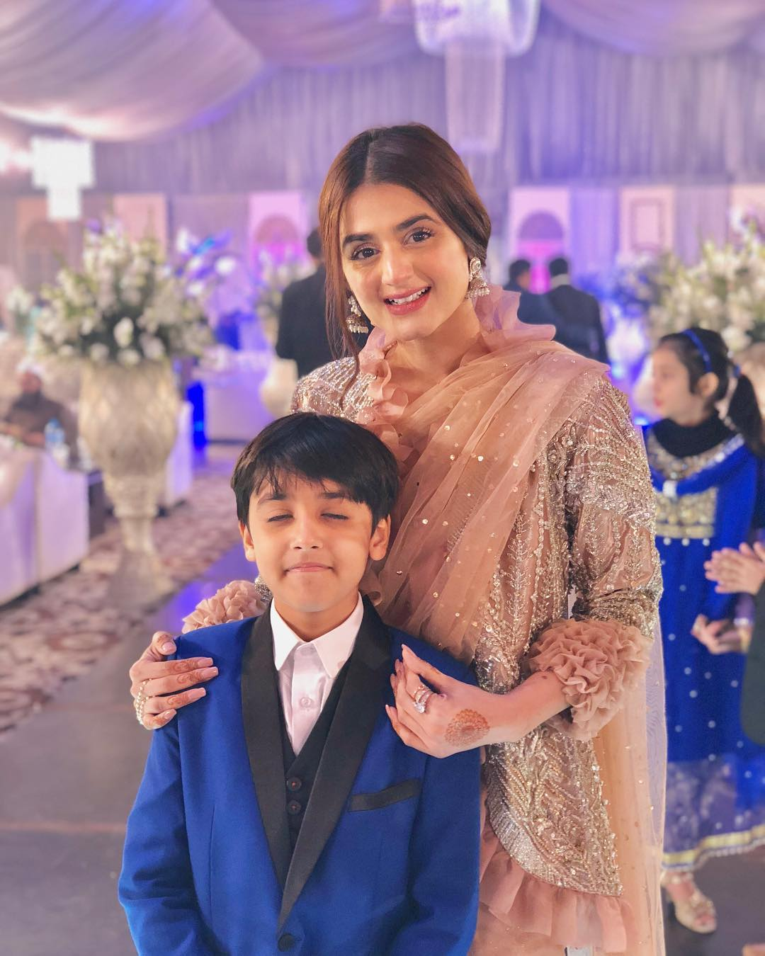 Beautiful Clicks of Hira and Mani with their Kids at a Wedding Event