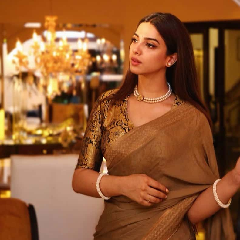 Gorgeous Sonya Hussyn in Royal Gold Saree with Pearl Necklace